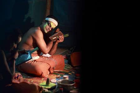 kathakali: MEZHUVELII, KERALA - MAR 01,2014-An unidentified Kathakali artists do make up before performance during the Shivarathri festival of the Shiva temple  in Mezhuveli, Kerala, India. Editorial
