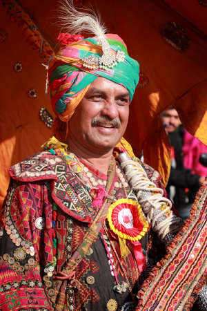 folk heritage: JAISALMER, INDIA - FEB 01,2015-Unidentified Rajasthani villager with colorful traditional dress attends a cultural procession for Desert festival held  in Jaisalmer, Rajasthan, India.
