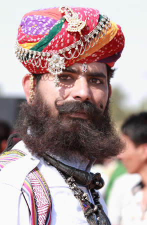 rajasthani: JAISALMER, INDIA - FEB 01,2015-Unidentified traditionally dressed Rajasthani man with long mustache and beard participates in the Desert Festival held in Jaisalmer, Rajasthan, India. Editorial