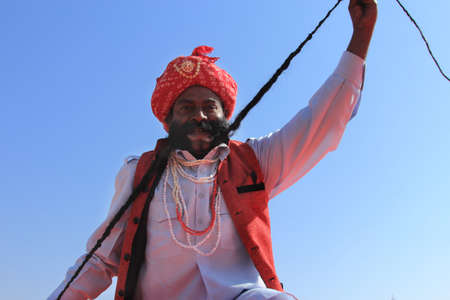 rajasthani: JAISALMER, INDIA - FEB 01,2015-An unidentified Rajasthani man participate in the Mr. Mushtache contest conducted as part of Desert Festival held in Jaisalmer, Rajasthan, India. Editorial