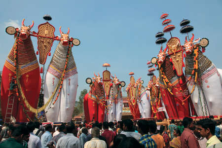 bullock animal: NOORANAD, INDIA - FEB 18,2015-Devotees look at the massive bullock effigies displayed during the Shivratrhri festival at Padanilam Parabrahma temple  in Nooranad,Kerala, India