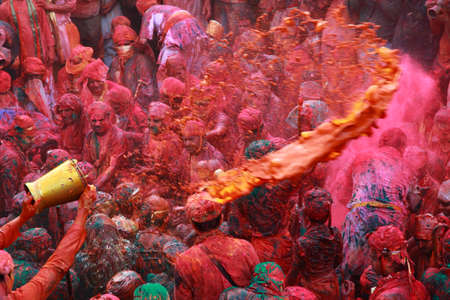 holi: NANDGAON - FEB 28,2015-Devotees throw colors to each other during the Holi celebration at Krishna temple in Nandgaon, India. Holi is the most celebrated religious festival in India. Editorial