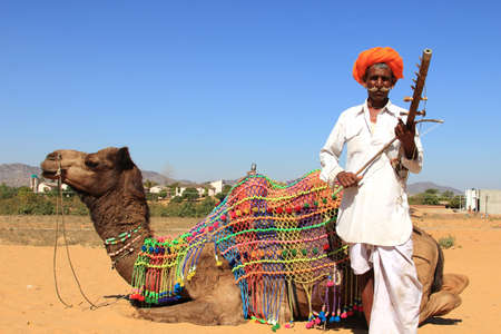 tribal dance: PUSHKAR, INDIA - FEB 5,2015-An unidentified nomad plays ravanahatha in the deserts  in Pushkar, India. Ravanahatha is an ancient instrument used by traditional folk singers in India. Editorial