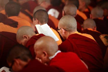 settlements: BYLAKUPPE, INDIA - MAR 27, 2015-  Buddhist monks do mass prayer at Namdroling Monastery  in Bylakuppe, India. Bylakuppe is second largest Tibetan refugee settlements in India.