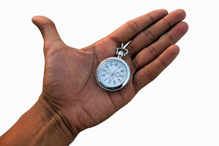 hand in pockets: Human hand holding a pocket watch. Stock Photo