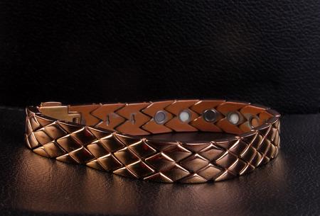 armlet: bracelet in black background
