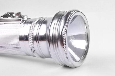 aluminum flashlight on a white background