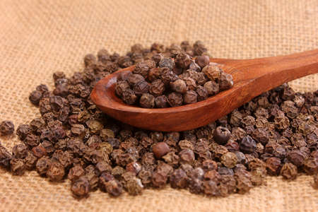wooden scoop: Black pepper in wooden scoop