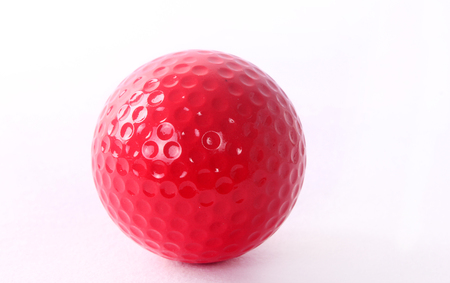 golf ball on red tee, white background Stock Photo