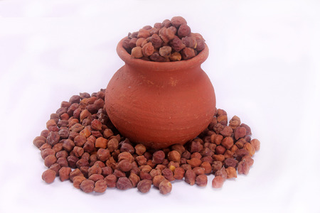 close up of a black chickpeas on a pot