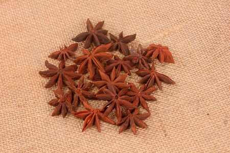 Star anise on dark wooden background, close-up