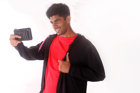 handsome young man: Happy young indian man taking a selfie photo