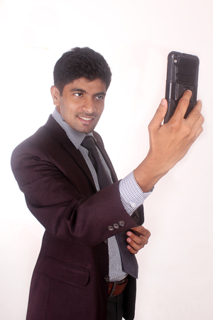 Happy young indian man taking a selfie photo