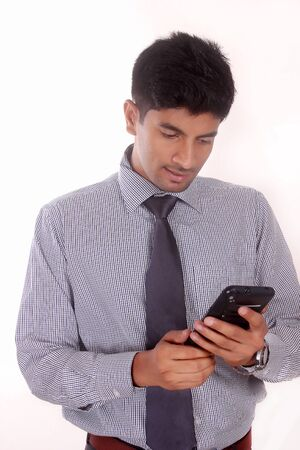young businessman looking mobile phone.