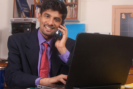 young indian businessman on the phone