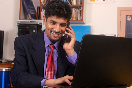 life style, business and people concept: Young business man using mobile phone.Over white background.