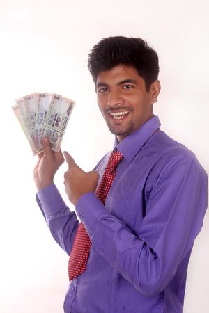 dhoti: business man holding money, isolated on white