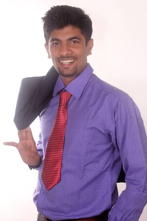 happy young smiling businessman of his success