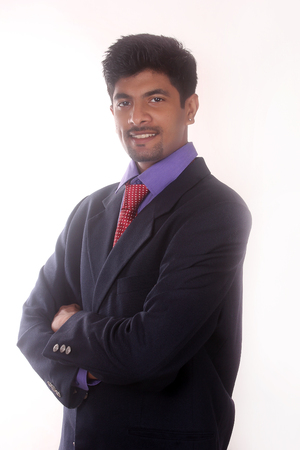 jubilate: happy young indian  smiling businessman of his success Stock Photo