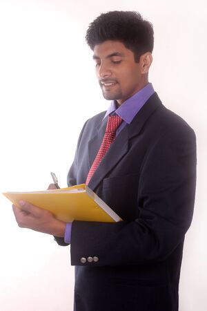 Portrait Of Businessman Writing a Paperwork at Office