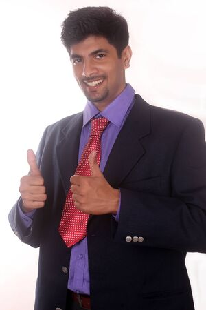 business man showing thumbs up gesture on white