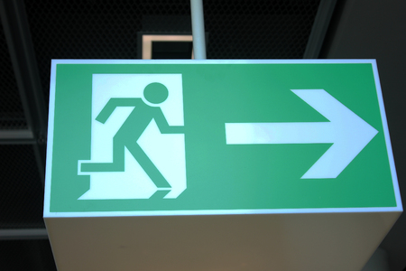 Evacuation signage in the international airport Stock Photo