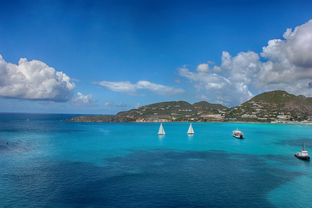 Blue clear water with rock mountains, boats,Yacht Stock Photo