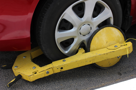 clamped: Clamped wheel of illegally parked car Stock Photo