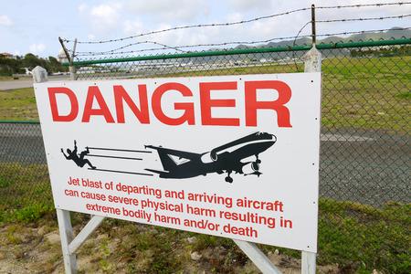 juliana: danger Warning sign at airport on Saint Martin island near Moho beach Stock Photo
