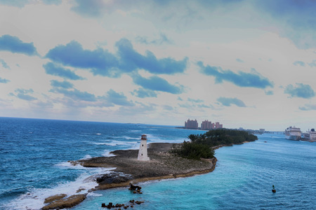 View of lighthouse in Nassau, Bahamas and cruise ships  in the city, Stock Photo