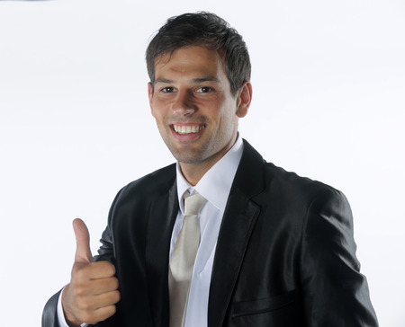 Smiling businessman with thumb up