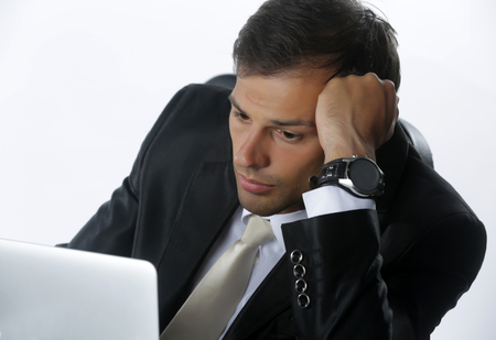 frustrated business man working on laptop computer at office