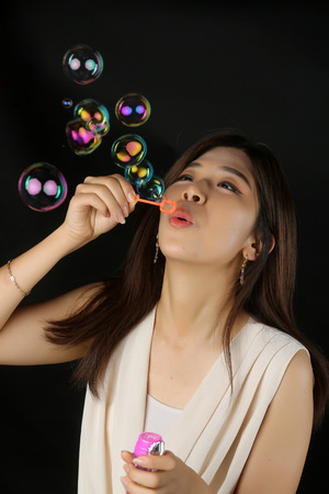 happy beautiful woman blowing soap bubbles  Stock Photo