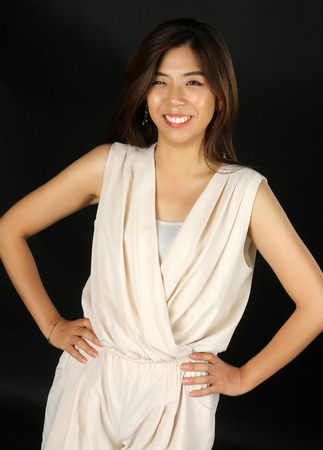 Beautiful sexy asian woman on black background.