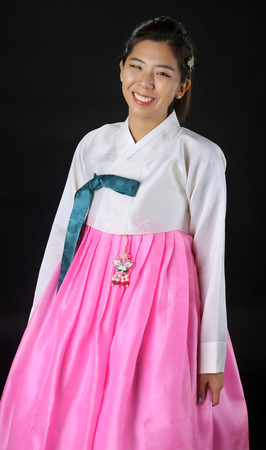 Woman with Hanbok, the traditional Korean dress. Stock Photo