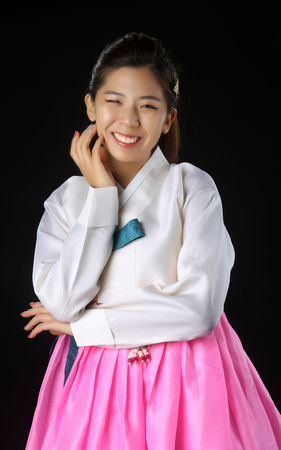 The woman wearing colorful Hanbok, Korean traditional dress isolated Stock Photo