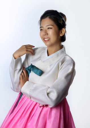 Korean Woman with Hanbok, the traditional Korean dress in white background with clipping path. Stock Photo
