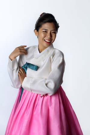 Asian woman wearing traditional korean hanbok with white  background. Stock Photo