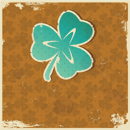 Stilyzed paper clover leaf on a grunge background