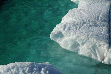 ice water: turquise water with drift ice Stock Photo