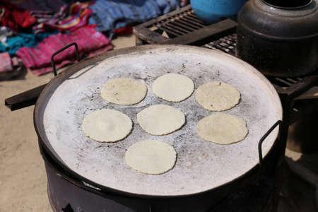 Baking tortillas on the fire - guatemalan pupusas 写真素材