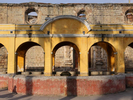 fasade: Beautiful. yellow colored laundry fountain at Antigua on Guatemala