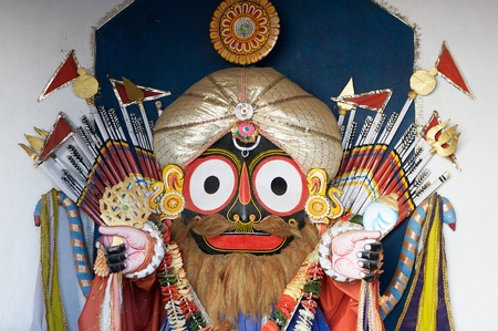 worshiped: Jagannath is a Hindu god worshiped primarly by the people of indian State of Orissa. The icon of Jagannath is a carved and decorated wooden stump with large round eyes.