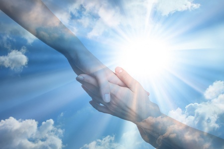 Hope of peace. Hands on the sunlight background
