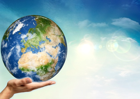 apporter: Apportez le monde dans une main Banque d'images