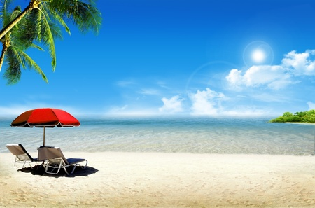 Tropical island: ocean sea and tropical beach with palm, beach umbrella and deck chair