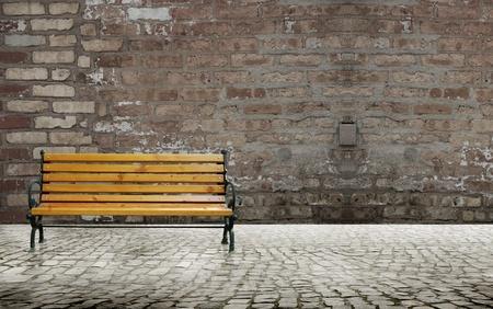 empedrado: Carretera pavimentada con silla banco y fondo de la pared de ladrillo