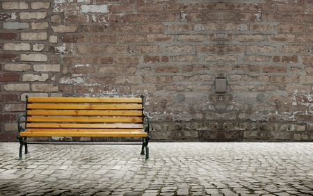 brick road: Paved road with bench chair and brick wall background
