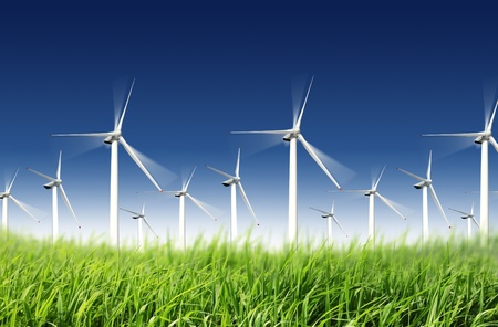 Wind farm: wind turbines in the grassland with blue sky in the background Stock Photo