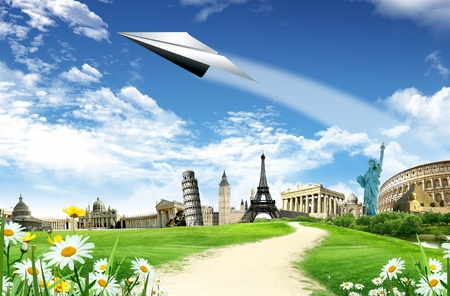 Travel around the world: landmarks with road and paper airplane is flying in the blue sky with clouds